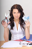 Business woman with euro and scissors Stock Photo