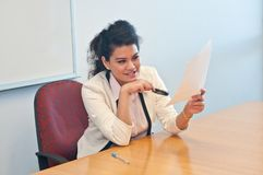 Business woman examine contract details by magnifier. And decide if something suspicious is there royalty free stock photo