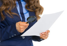 Business woman examining document using magnifying glass. Closeup on business woman examining document using magnifying glass Stock Images