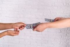 Business woman exchanging dollar bills. royalty free stock photography