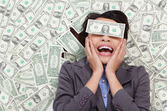 Business woman excited lying on money Stock Photo