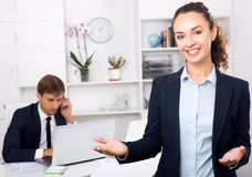 Business woman executive manager standing in company office. Pretty young business women executive manager standing in company office stock images