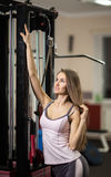 Business woman exercising on a fitness machine in a fitness class at the fitness center Stock Photography