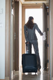 Business woman exiting hotel room . rear view Royalty Free Stock Photo