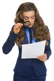 Business woman exploring document. With magnifying lens Stock Image