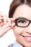 Business woman with eye glasses. Glasses eyewear closeup of business woman holding eye glasses frame smiling happy. Beautiful young Asian woman Stock Photo