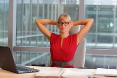 Business woman in eyeglasses relaxing neck Stock Images
