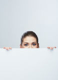 Business woman face looking out white banner. Stock Images