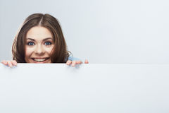 Business woman face looking out white banner. Stock Photo