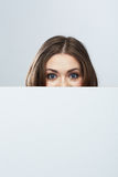 Business woman face looking out white banner. Royalty Free Stock Photography