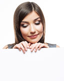 Business woman face looks out advertising billboar Royalty Free Stock Images