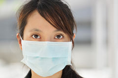Business woman with face mask Royalty Free Stock Image