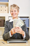 Business woman with fan of dollar Royalty Free Stock Images