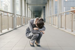Business woman feel helpless and sadness. And squat on ground in city Royalty Free Stock Photos