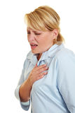 Business woman feeling heart pain. And holding her chest Royalty Free Stock Images