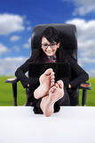 Business Woman with Feet Up on a Table Stock Images