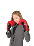 Business Woman Fighter. A business woman with boxing gloves ready to fight or do battle Stock Photography