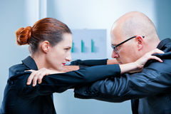 Business woman fighting business man Stock Photos