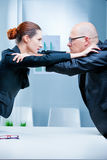 Business woman fighting business man Royalty Free Stock Photo