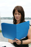 Business woman with a file folder Royalty Free Stock Photo