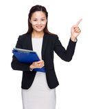 Business woman with file pad and finger point out Stock Image