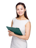 Business woman with file pad Stock Photography