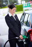 Business woman filling car at gas station Royalty Free Stock Photos