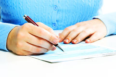 Business woman filling document. Royalty Free Stock Image