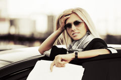 Business woman with financial papers at the car Royalty Free Stock Images