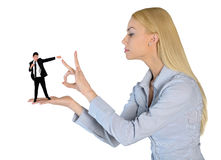 Business woman finger flipping on little man Royalty Free Stock Images