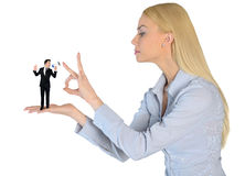 Business woman finger flipping on little man Stock Photography