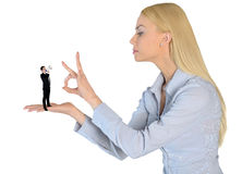 Business woman finger flipping on little man Royalty Free Stock Photos