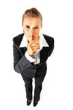 Business woman with finger at mouth. shh gesture Stock Photography