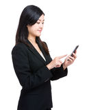 Business woman finger touch on mobile phone Stock Image