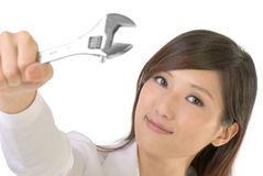 Business woman fix. By using wrench with smile on white background royalty free stock photos