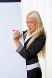 Business woman on a flip chart Royalty Free Stock Image