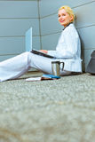 Business woman on floor at office building stock photo