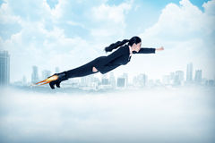 Business woman flying with rocket on her shoes Royalty Free Stock Photography