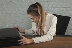 Business woman focused on the cipher in the briefcase royalty free stock photography
