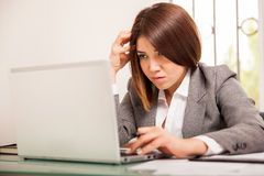 Business woman focused at work Royalty Free Stock Photo