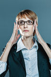 Business woman focusing herself with hands on her spectacles Royalty Free Stock Photo