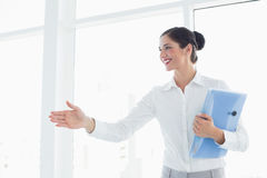 Business woman with folder entering office cabin Royalty Free Stock Photo