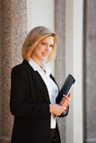 Happy young fashion business woman with a folder Stock Photo
