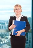 Business woman with folder in the office Royalty Free Stock Images