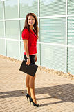 The business woman with a folder for papers Stock Images