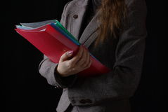 Business woman with folders Royalty Free Stock Image