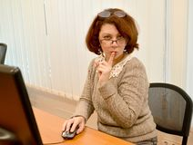 The business woman with a forefinger at lips keeps a secret.  Royalty Free Stock Images