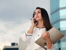 Business woman in formal clothes talking on the phone stock photo