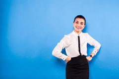Business woman in formal wear on blue background royalty free stock photo