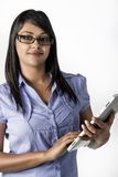 Business Woman with framed glasses type tablet Royalty Free Stock Images